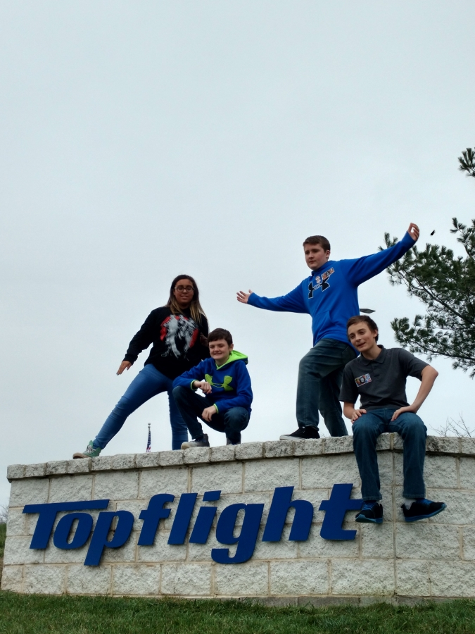Top Flight sign & students