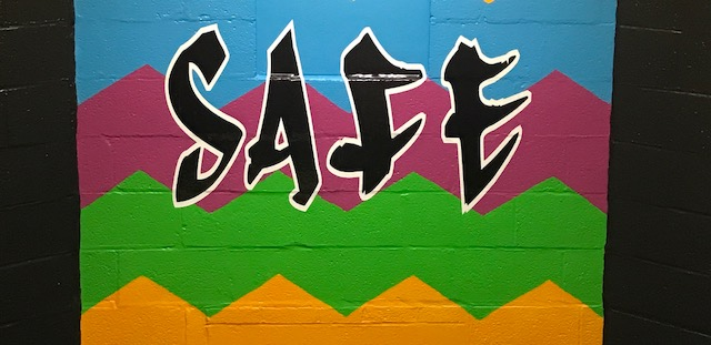 "Mural in SEMS stairway showing the word ""Safe""."