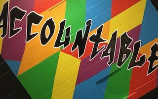 "Mural in SEMS stairway showing the word ""Accountable""."